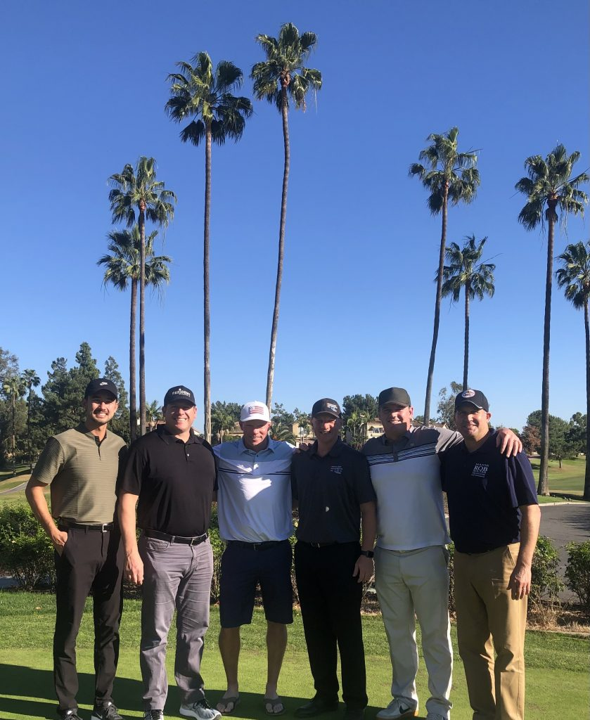 men posed for photo on golf course